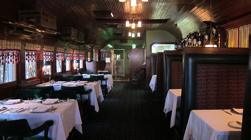 Inside view with boths and table with white table linens