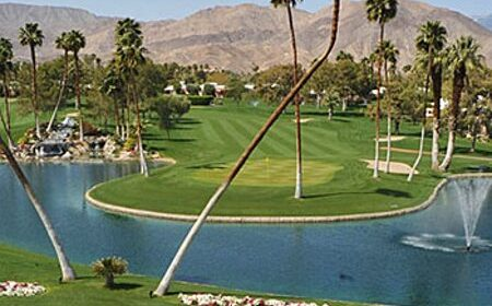 golf course withwater and canyons