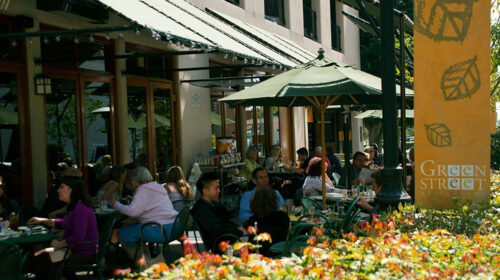 Outside store front with people dinning