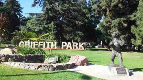 sign of Griffith Park, trees and scrubs