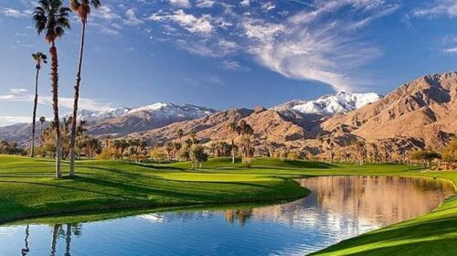 Golf course view with water and canyons