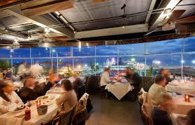 People sitting at table with white table cloth's