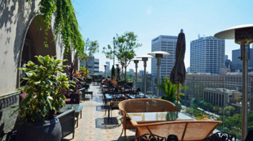 Rooftop tables and chairs with city view