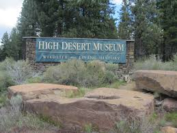 sign of museum with boulders and grass surrounding it